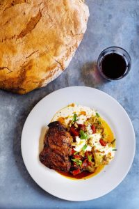 Butterflied lamb with aubergine and red pepper salad
