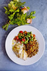 Charcoal grilled sea bass with jewelled rice and tahini